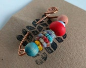 One of Kind Multi Bead Fibula Style Pin from handcrafted wool, yarn, polymer clay, copper, glass and dyed wood beads