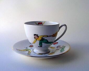 vintage women curling team on a royal standard porcelain teacup and saucer made in england