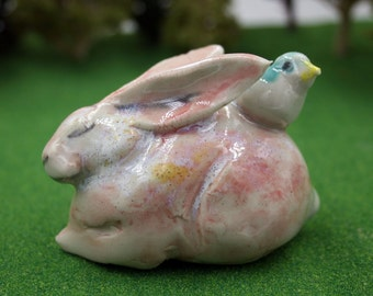 rabbit figurine -  pink bunny with bird - porcelain sculpture