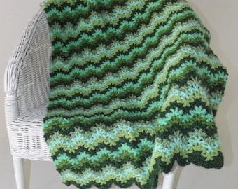 Crochet baby blanket in multiple tones of green