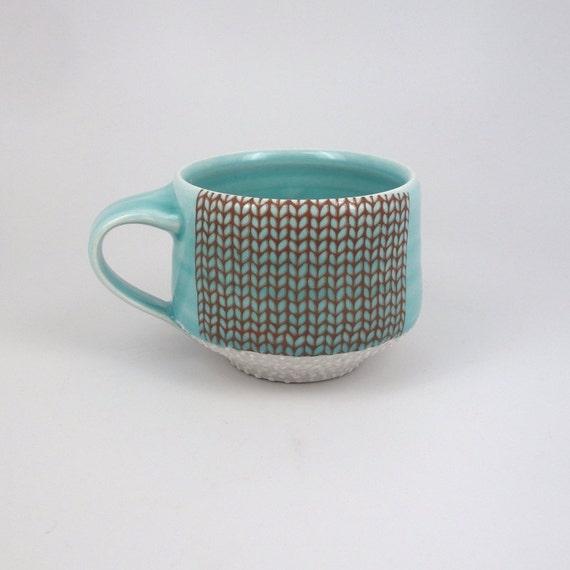 Aquamarine glazed porcelain mug with knit pattern and dotted texture