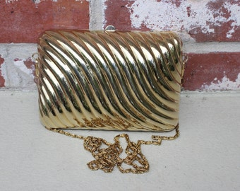 Gold metal ribbed box clutch with gold chain