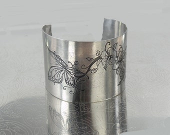 Stainless steel, etched cuff bracelet, butterflies and flowers
