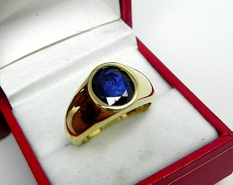 AAA Blue Sapphire 10x8mm 2.48 Carats in  Heavy 18K Yellow gold MAN'S ring 20 grams. 2576