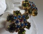 Vintage rhinestone flower blossom earrings clip on earrings green blue and hot pink rhinestones gold tone metal