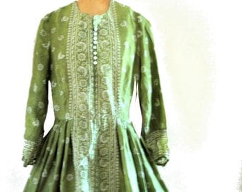 Boho vintage 70s olive green silk , hand made dress with a white color novelty print of the exotic birds and flowers. Size Small.