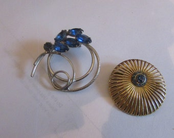 two blue brooches