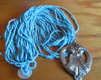 baby blue seed necklace
