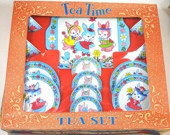 Spring Bunnies Tin Toy Tea Set, 13 piece set in orginal box, near mint.
