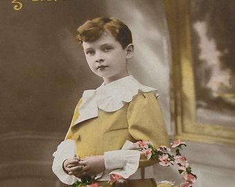 Antique French postcard, Edwardian boy in yellow, RPPC paper ephemera.