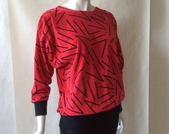 1980's Michael Carrie Keith Haring style graphic print velour sweater, deep coral pink & black, slouchy with batwing sleeves, medium / large