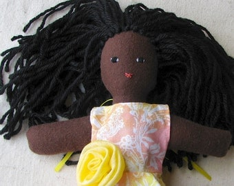 African American doll, dark chocolate brown skin, black hair, yellow, pink & white floral dress, 10 inch