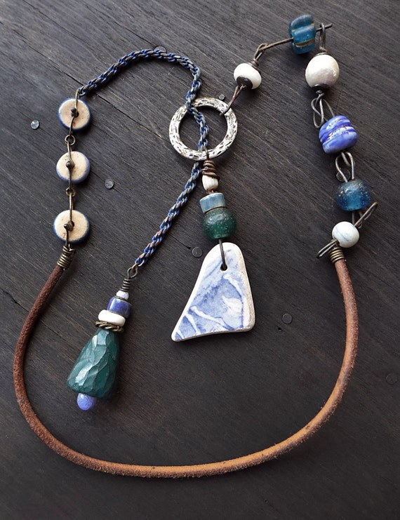 Euphonia. Artisan lariat necklace with vintage beads and sea pottery in blue, green, and white. Mixed media jewelry.