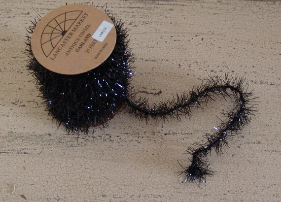 Black vintage tinsel garland lancaster market foot spool