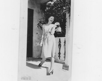 original 1930-40s photo. a girl with a whiskey jug