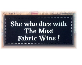 She who dies with the most fabric wins primitive wood sign Sewing room