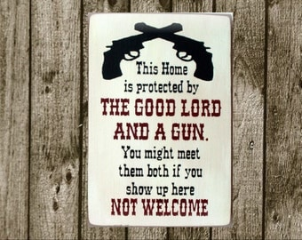 This home is protected by the Good Lord and a Gun...wood sign