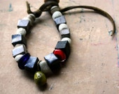 De Stijl, Bracelet with Artisan Lampwork, Stoneware, Antique White Greenheart Glass, Dogon Glass, and Yak Bone On Waxed Buckskin Leather