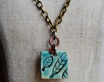 Soft Turquoise Green Leaf Ceramic pendant, Tiny pendant, ceramic jewelry, hand cut porcelain leaf pendant, tiny leaf jewelry