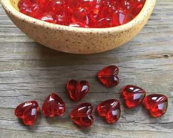 20 bright red glossy plastic hearts