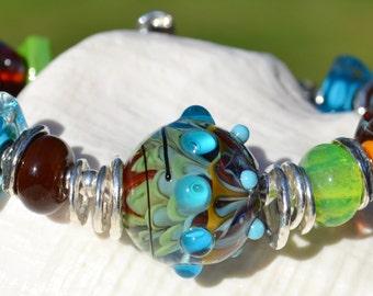 Reserve for Cheryl-WINDING ROADS-Handmade Lamp Work and Sterling Silver Bracelet