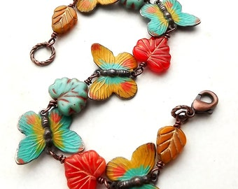 Fall jewelry, beautiful hand painted butterfly bracelet with glass leaves, bright colors