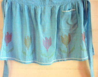 Turquoise and white vintage gingham apron with multi coloured cross stitch and ric rac
