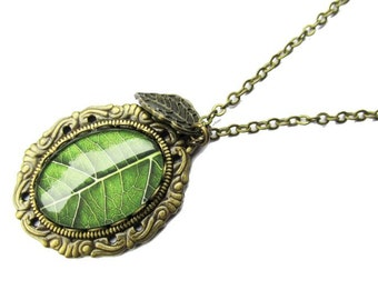Nature Inspired Green Leaf Glass Dome Pendant Necklace on antique brass chain
