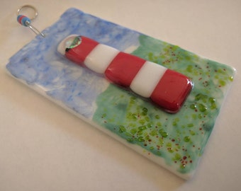 Lighthouse fused glass hanging ornament.