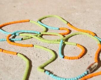 aqua, orange, and green necklace