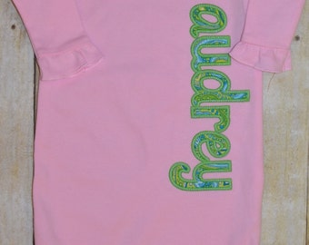 Name appliqued baby gown.