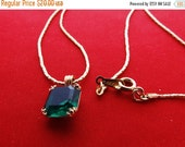 "20% off sale Vintage AVON 18"" gold tone necklace with .5"" emerald green rhinestone pendant in great condition, appears unworn"