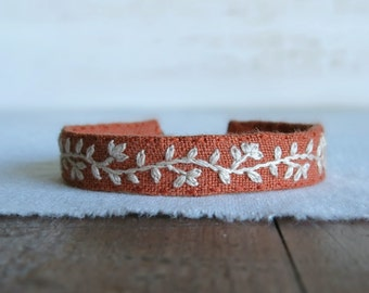Linen Cuff Bracelet - Cream Floral Embroidery on Burnt Orange Linen