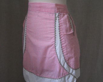 25 per cent off. Use coupon code HOLIDAYHAPPINESS2.CLOSING SALE Vintage handmade pink gingham apron with pockets and grey rickrack trim