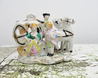 Vintage horse and carriage figurine