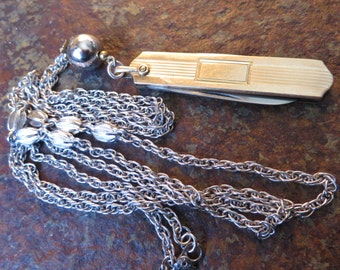 Art Deco Gold Knife Necklace Voos Stainless blades by Simmons on a Silver Monet chain