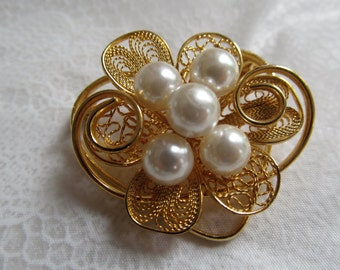 EM signed vintage brooch with gold colored metal filigree and faux pearls
