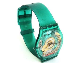anyone got the time  ....    vintage swatch watch  ...   green swatch skin