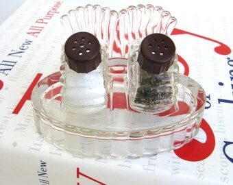 art deco  ...  vintage pressed glass salt and pepper shakers sitting on a glass tray