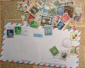 Over 100 Vintage POSTAGE Stamps in an old AIR MAIL Envelope for assemblage collage art jewelry