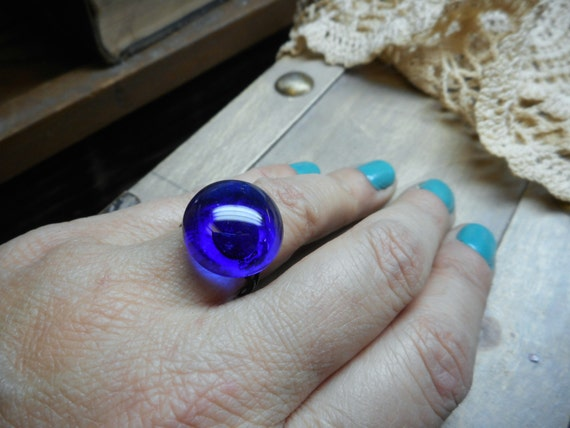 Indie Moon Cocktail Ring. Dark indigo Blue Glass Domed Cabochon and antiqued brass ring . Boho
