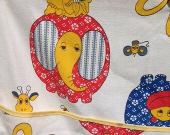 Adorable vintage retro hanging nursery diaper organizer elephants hippos frogs giraffes monkeys rabbits in red blue and yellow