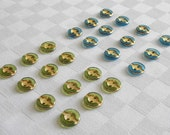 24  fabulous  tiny  2-hole semi transparent glass buttons - with very nice golden trim -   (11 mm - 7/16 in.)