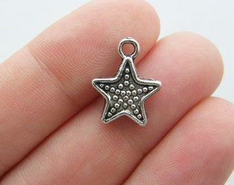 10 Starfish charms antique silver tone FF275