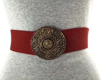 vintage 80s burgundy stretch belt aztec medallion round brass metal buckle elastic small medium women retro fashion accessories waist red