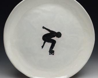 Skateboarder plate, ceramic serving platter black and white majolica glazed pottery ollie silhouette