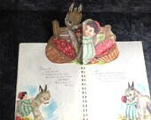 "Vintage childrens pop up book ""Davey and the First Christmas"" and a ceramic cup"