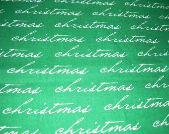 "Christmas - Christmas script on green - cotton fabric -  43"" wide - sold by the yard"