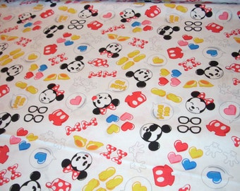 """Mickey Mouse and Minnie Icons on white cotton fabric  -  44"""" wide - sold by the yard"""
