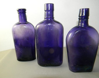 Trio of Upcycled Antique Purple Glass Liquor Flasks
